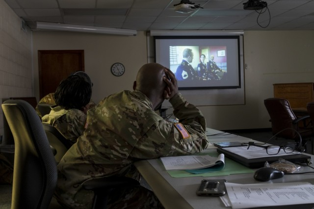 U.S. Army Reserve Soldiers with the 335th Signal Command (Theater) watch a video during a Casualty Notification and Assistance Course at the headquarters in East Point, Georgia, June 11, 2019.  The Army provides training to prepare casualty notification and assistance officers for the emotional aftereffects of bearing sad tidings.  (U.S. Army Reserve photo by Capt. David Gasperson)