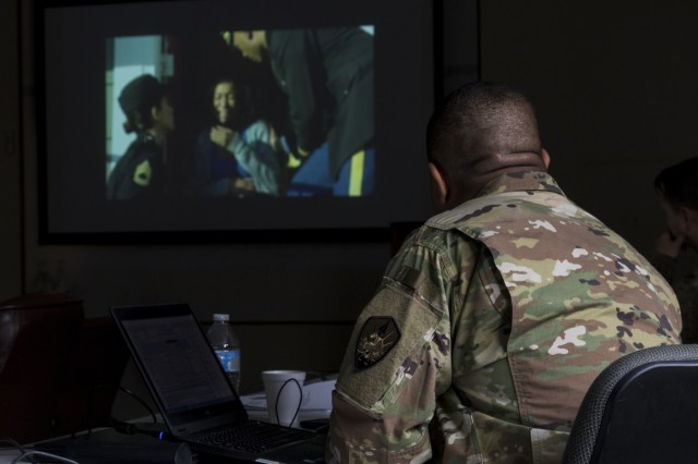 U.S. Army Reserve Maj. Julius Penn, public affairs officer with the Joint Enabling Capabilities Command-Army Reserve Element watches a video during a Casualty Notification and Assistance Course at the 335th Signal Command (Theater) headquarters in East Point, Ga. June 11, 2019.  The Army provides training to prepare casualty notification and assistance officers for the emotional aftereffects of bearing sad tidings.  (U.S. Army Reserve photo by Capt. David Gasperson)