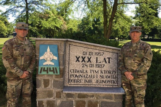 Capt. Jason D. Little, Jr. and Command Sgt. Maj. Jason D. Little, Sr., 184th Sustainment Command, pose for a photo in Poland. (Courtesy Photo)