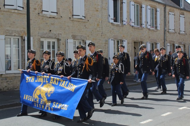 Cadets of 9TH JROTC Batallion march in the parade at Sainte Mere Eglise during their visit to Normandy June 2019 .