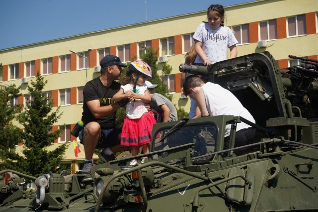 Romanian locals check out the 30mm Stryker Infantry Vehicle - Dragoon during 1st Squadron, 2d Cavalry Regiment's Saber Guardian 2019 static display in Sibiu, Romania, June 15, 2019. SG19 is an exercise co-led by the Romanian Land Forces & U.S. Army Europe, taking place from June 3 - 24 at various locations in Bulgaria, Hungary & Romania. SG19 is designed to improve the integration of multinational combat forces.