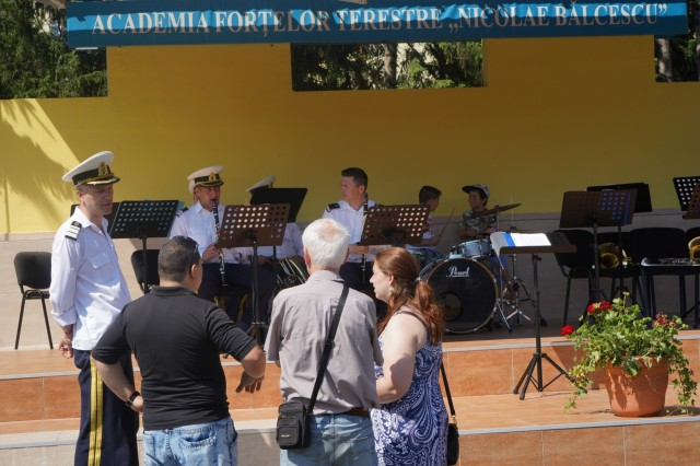 The military band from the Nicolae Bălcescu Land Forces Academy performs during the 1st Squadron, 2d Cavalry Regiment's Saber Guardian 2019 static display in Sibiu, Romania, June 15, 2019. SG19 is an exercise co-led by the Romanian Land Forces & U.S. Army Europe, taking place from June 3 - 24 at various locations in Bulgaria, Hungary & Romania. SG19 is designed to improve the integration of multinational combat forces.