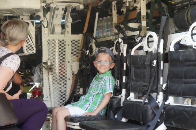 A Romanian child takes a seat in the 30mm Stryker Infantry Vehicle - Dragoon during the 1st Squadron, 2d Cavalry Regiment's Saber Guardian 2019 static display in Sibiu, Romania, June 15, 2019. SG19 is an exercise co-led by the Romanian Land Forces & U.S. Army Europe, taking place from June 3 - 24 at various locations in Bulgaria, Hungary & Romania. SG19 is designed to improve the integration of multinational combat forces.