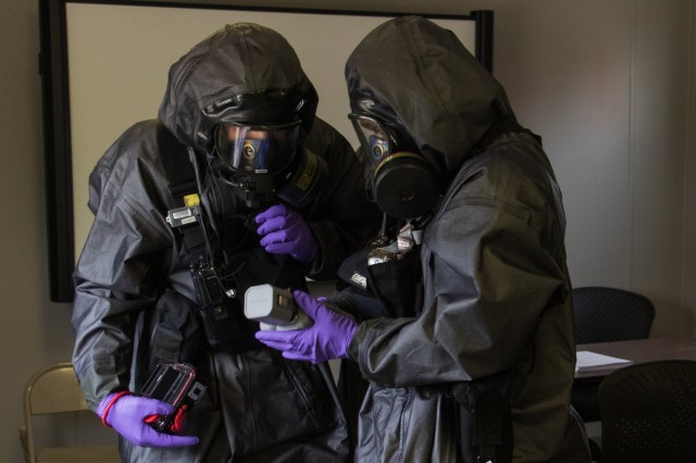 Georgia National Guardsmen with the Marietta based 4th Civil Support Team (Weapons of Mass Destruction) determine the chemical make-up and an unknown chemical agent during a training exercise at the Memphis Fire Department Training Center in Memphis, Tenn., on June 4, 2019. The CST specializes in the identification and mediation of unknown chemical substances.