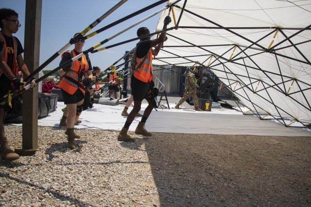 Georgia National Guardsmen with the Marietta based 138th Chemical Company, lift a large section of the tent during training at the Memphis Fire Department Training Center in Memphis, Tenn., on June 4, 2019. Approximately seven of these sections form the decontamination lane to quickly treat civilian casualties.