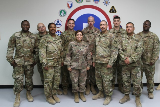 Soldiers of the 320th Quartermaster Detachment stand together at Camp Arifjan, Kuwait, June 8, 2019. (U.S. Army National Guard photo by Sgt. Ashley Breland)