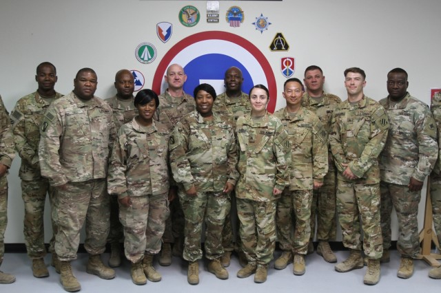 Soldier of the 590th Quartermaster Detachment stand for a photo at Camp Arifjan, Kuwait, June 8, 2019. (U.S. Army National Guard photo by Sgt. Ashley Breland)