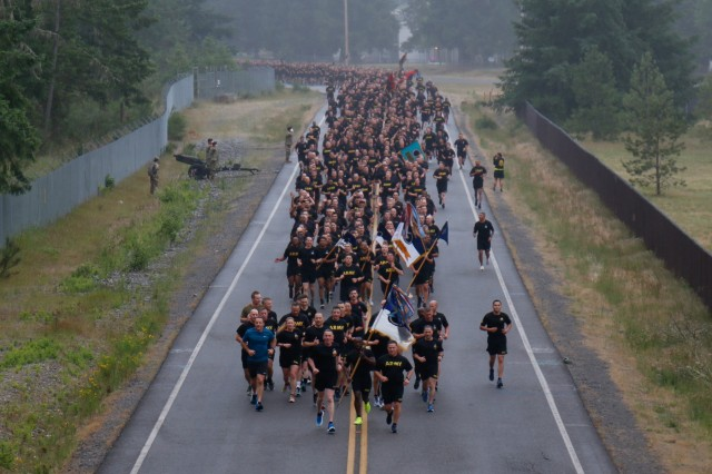 Lt. Gen. Gary Volesky, I Corps commanding general, leads the formation in a run celebrating the Army's 244th birthday at Joint Base Lewis-McChord June 14.