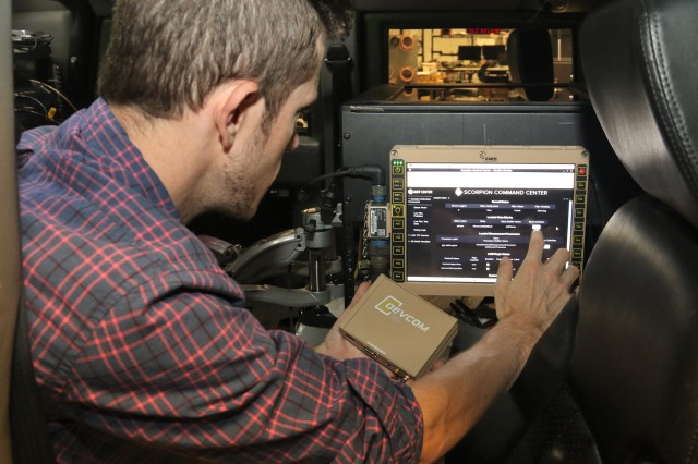 C5ISR Center computer scientist Zach Kjellberg conducts testing on a position, navigation and testing system at Aberdeen Proving Ground, Md., on June 13, 2019.