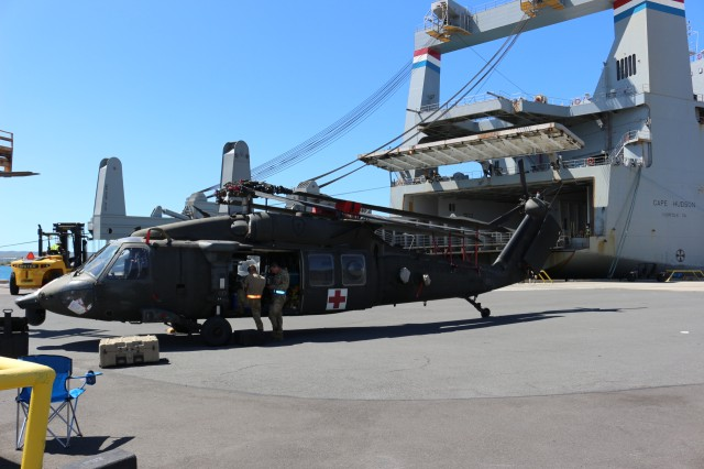 25th Soldiers work on a Black Hawk helicopter after offloading it from the M/V Cape Hudson during port operations at Pearl Harbor on June 12.