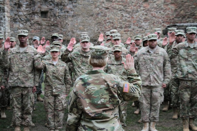 Col. Michelle M.T. Letcher, commander of the 16th Sustainment Brigade, administers the oath of reenlistment to 53 Soldiers during a mass reenlistment ceremony in Kusel, Germany. More than 80% of eligible Soldiers have already reenlisted in fiscal year 2019, surpassing the Army's targeted goal five months early.