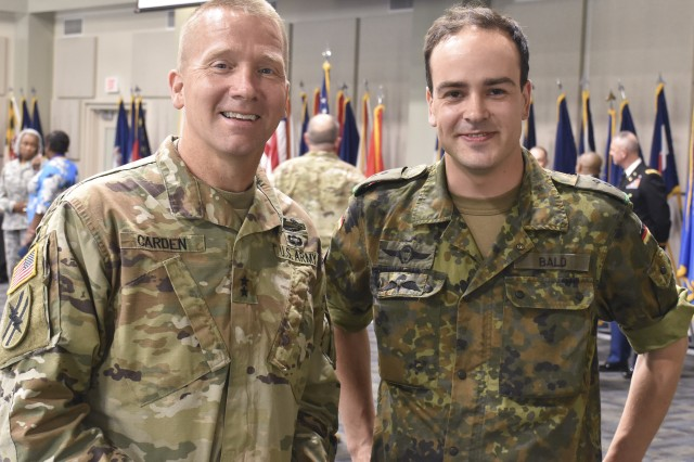Georgia's Adjutant General, Maj. Gen. Thomas M. Carden Jr., greets German Reserve Bundeswehr Capt. Moritz Bald during a ceremony at the Clay National Guard Center, Marietta, Ga., on June 7, 2019. Bald was in the country on a two-week reserve exchange program between Germany and the Georgia Army National Guard.