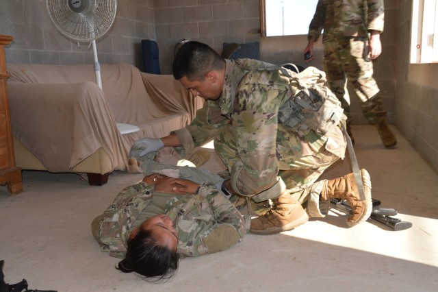 Army Sgt. Kevin Ramirez assesses a casualty June 12, 2019 during the tactical combat casualty care portion of the Brooke Army Medical Center Best Medic Competition at Camp Bullis, Texas. The competitors were tested on both warrior and medic skills during the competition.