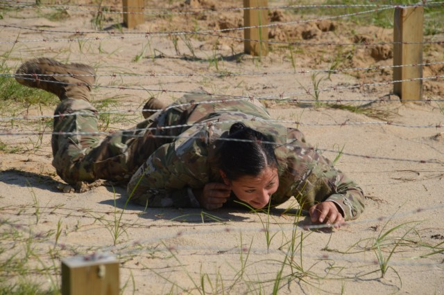 Army 1st Lt. Samantha Frank low crawls during the Brooke Army Medical Center Best Medic Competition June 12, 2019 at Camp Bullis, Texas. BAMC Soldiers competed for the title of Best Medic during the grueling competition with included an obstacle course.