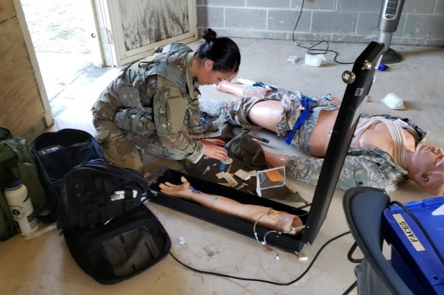Army Sgt. Samantha Delgado assesses a patient June 12, 2019 during the medical lane portion of the Brooke Army Medical Center Best Medic Competition at Camp Bullis, Texas. The Soldiers competed in several warrior and medical tasks during the grueling competition.