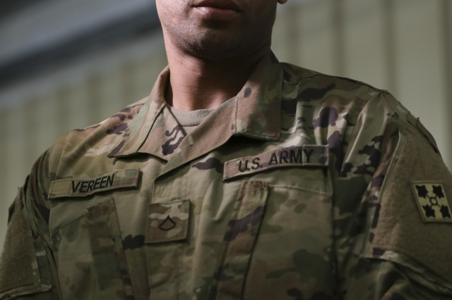 Private 1st Class Kevin Vereen, Jr., assigned to Signal, Intelligence, and Sustainment Company, Headquarters and Headquarters Battalion, 4th Infantry Division, poses for portrait at Fort Carson, Colo., May 30, 2019. Following in his father's footsteps, Vereen said that he did not imagine that a dream to be a professional football player would lead him to a career in the military.