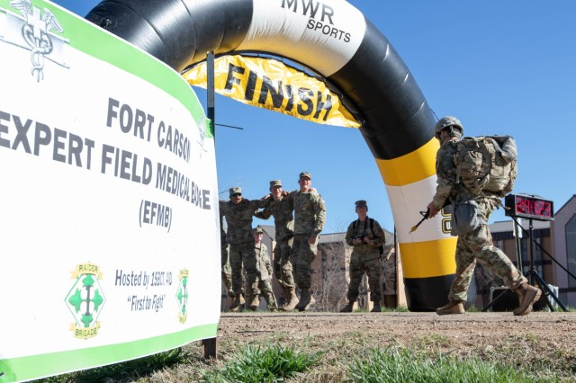 A candidate approaches the finish line of the 12-mile ruck march in under three hours while competing for the 2019 Fort Carson Expert Field Medical Badge April 19, 2019, Fort Carson, Colorado. The EFMB is the non-combat equivalent of the Combat Medical Badge and is awarded to medical personnel of the U.S. military who successfully complete a set of qualification tests. (U.S. Army photo by Sgt. Daphney Black)