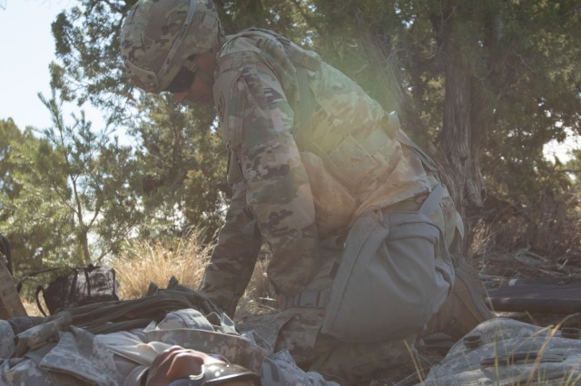 Sgt. Tyson Ray, Headquarters and Headquarters Company, 4th Battalion, 9th Infantry Regiment, 1st Stryker Brigade Combat Team, 4th Infantry Division, a candidate for the Expert Field Medical Badge, performs medical aid on a simulated casualty as part of testing standardization for the EFMB at Fort Carson, Colorado, April 10, 2019. Qualification for EFMB includes a multitude of events such as land navigation, physical fitness test, medical evacuations, weapons function checks, ruck march,  written test, and medical treatments. (U.S. Army photo by Sgt. Inez Hammon)