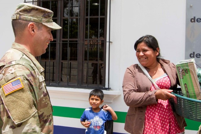 U.S. Army Reserve Sgt. Geiber Rea, an interpreter with 300th Military Intelligence Brigade, out of Draper, Utah, presents flyers promoting a free medical event to local citizens of Chilanta, Guatemala on June 6 during Beyond the Horizon 2019. Beyond the Horizon is a joint training exercise focused on improving the operational readiness of U.S. Forces and providing tangible benefits to the people of Guatemala