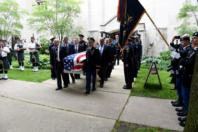 Pallbearers carry the casket of Staff Sgt. Al Mampre to a waiting hearse following a funeral service on Saturday, June 15, 2019, at St. Luke's Episcopal Church in Evanston. Mampre enlisted in the Army in 1942 and served as a medic with Easy Company, 2nd Battalion, 506th Parachute Infantry Regiment, 101st Airborne Division during World War II.  Mampre was one of the 'Band of Brothers' whose exploits were made into an HBO television series and also a book by historian Stephen Ambrose. Mampre died May 31, 2019, in Evanston. Soldiers from the 101st Airborne Division; Brig. Gen. Kris A. Belanger, Commanding General, 85th U.S. Army Reserve Support Command and representatives from several police departments took part in the funeral service. Belanger became friends with Mampre after meeting him at a Memorial Day ceremony in 2018. (U.S. Army Reserve photos by Sgt. David Lietz)