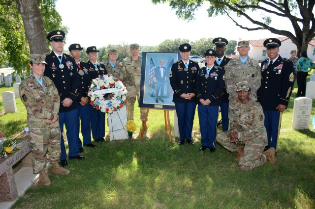 Members of the Sergeant Major of the Army (SMA) Leon L. Van Autreve Chapter, Sergeant Audie Murphy Club, with CSM Napoleon Noguerapayan (right), Commandant, AMEDD NCO Academy pose in front of a portrait of SMA L eon L. Van Autreve.