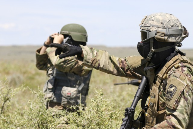 100th Missile Defense Brigade (GMD) Soldiers participate in a Situational Training Exercise at the Piñon Canyon Maneuver Site, near Trinidad, Colo., June 13, 2019. The Soldiers conducted squad level movement, maneuver and assault operations using simulated rounds, aided by the 2-135th General Support Aviation Battalion of the Colorado Army National Guard, who provided one UH-60 Black Hawk helicopter for airlift and medevac training and operations.