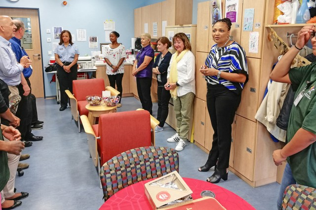 Rashunda Clement (second from right), Wiesbaden Child and Youth Services coordinator, thanks the staff of the Hainerberg School Age Center for their dedicated efforts in ensuring excellent care of military children at the facility.