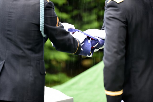 Soldiers from the 101st Airborne Division fold the flag during a graveside service for Staff Sgt. Al Mampre. Mampre served as a medic with Easy Company, 2nd Battalion, 506th Parachute Infantry Regiment, 101st Airborne Division during World War II. He was one of the 'Band of Brothers' whose exploits were made into an HBO television series and also a book by historian Stephen Ambrose.