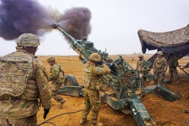 Soldiers assigned to the Field Artillery Squadron, 3rd Cavalry Regiment, fire their M777 howitzer on Firebase Saham, Iraq, Dec. 3, 2018. Leaders from the regiment spoke about the unit's nine-month deployment during an Army Current Operations Engagement Tour at the Pentagon in Washington, D.C., June 19, 2019.