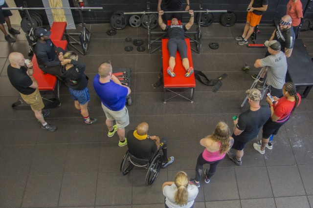 U.S. Army competitors watch a Powerlifting demonstration during practice on June 18, 2019, at MacDill Airforce Base, Florida during the 2019 Department of Defense Warrior Games. The DoD Warrior Games are conducted June 21- 30, hosted by Special Operations Command, Tampa, Florida. It is an adaptive sports competition for wounded, ill and injured service members and veterans. Approximately 300 athletes representing teams from the Army, Marine Corps, Navy, Air Force, Special Operations Command, United Kingdom Armed Forces, Armed Forces of the Netherlands, and the Danish Armed Forces will compete in archery, cycling, shooting, sitting vollyball, swimming, track, field, wheelchair basketball, indoor rowing, powerlifting, and for the first time in Warrior Games history, golf, wheelchair tennis, wheelchair rugby, and mountain biking. (U.S. Army photo by Spc. Samantha Ruiz)