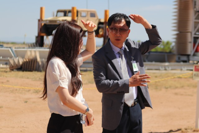 Ms. Jang Bo-young and Mr. Jung Jae-Soo discuss an antenna at the Antenna Test Facility