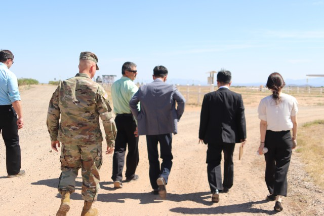 Col. Daniel Martin and the Korean delegation on their way to the Antenna Test Facility Range