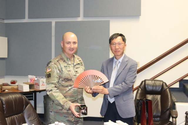Col. Martin and Jae-Soo exchange gifts at the culmination of the visit.
