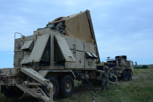 """Soldiers with Bravo Battery, 3rd Battalion, 2nd Air Defense Artillery Regiment prepare a Patriot missile radar for movement to another field location under a Table VII assessment at Fort Sill, Okla., June 18, 2019. The Army completed a """"sense-off"""" capabilities demonstration June 17 of prototype radars aimed at replacing this system currently used by Patriot missile units."""
