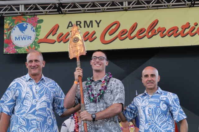Gen. Robert Brown (left), the commanding general of U.S. Army Pacific and Command Sgt. Maj. Benjamin Jones, the command sergeant major of U.S. Army Pacific (right), present Spc. Alexander Vandermark (middle) with a spear for winning the U.S. Army Pacific Best Warrior Competition, Soldier of the year on June 14, 2019, at Weyland Field, Schofield Barracks, Hawaii.