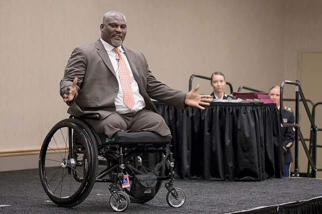 Retired Col. Greg Gadson offers words of appreciation and inspiration in his keynote address to the Madigan Army Medical Center's graduation ceremony for healthcare professionals on June 14 at American Lake Conference Center on Joint Base Lewis-McChord, Wash.