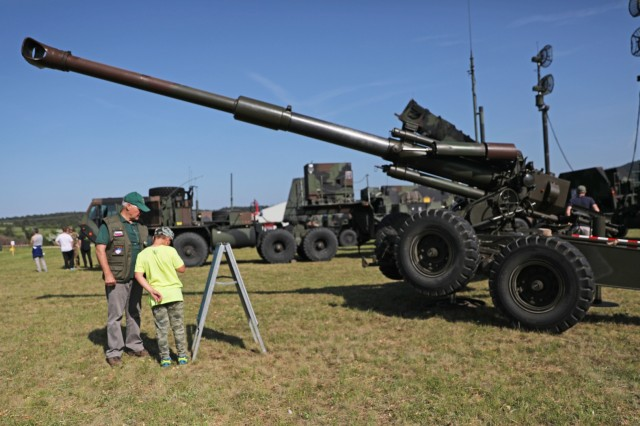 Visitors tour static displays of U.S. Army and Slovenian armed forces equipment at a community engagement event June 8, 2019 in Divaca, Slovenia. The event showcased both militaries' vehicles, aircraft and equipment and included live demonstrations. U.S. Army photo by Sgt. Erica Earl