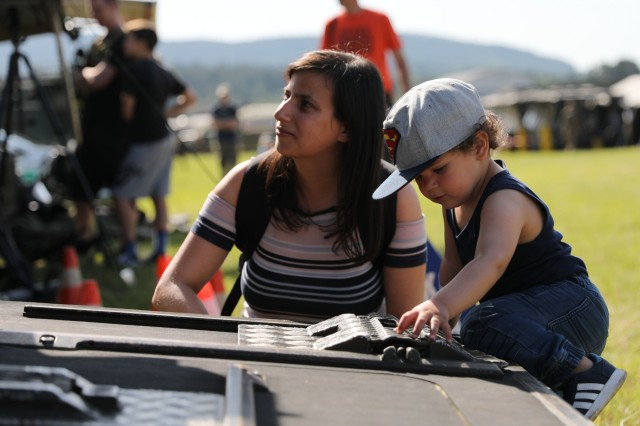 A child explores static displays of U.S. Army and Slovenian armed forces equipment at a community engagement event June 8, 2019 in Divaca, Slovenia. The community day followed exercise Astral Knight 19, a joint air and missile defense exercise. U.S. Army photo by Sgt. Erica Earl