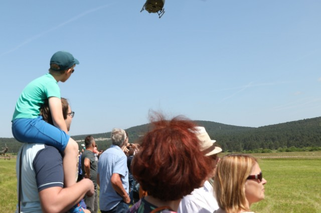 Visitors watch a flyover demonstration at a community engagement event June 8, 2019 in Divaca, Slovenia. The event showcased both the U.S. and Slovenian militaries' equipment, vehicles and aircraft. U.S. Army photo by Sgt. Erica Earl