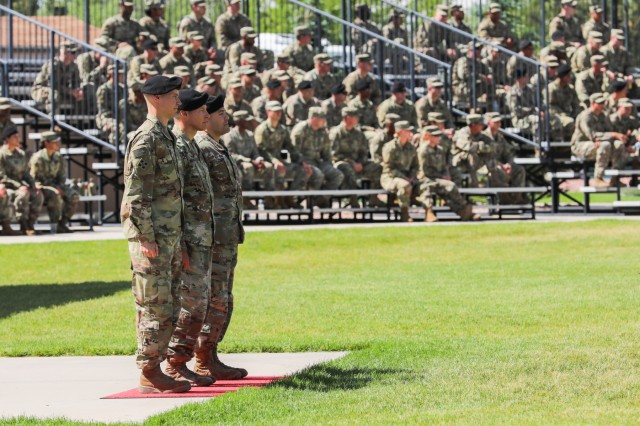 Col. Dave Zinn, left, outgoing commander, Brig. Gen. Joseph A. Ryan, middle, reviewing officer, and Col. Scott P. Knight Jr., right, incoming commander, stand in front of the Soldiers of the , 2nd Infantry Brigade Combat Team, 4th Infantry Division, during a 2IBCT, 4th Inf. Div. change of leadership ceremony, June 13, 2019, on Fort Carson, Colorado. Zinn and Command Sgt. Maj. Vincent Simonetti relinquished authority and responsibility of the brigade to Knight and Command Sgt. Maj. Steve R. Chandler Jr. (U.S. Army photo by Staff Sgt. Neysa Canfield)
