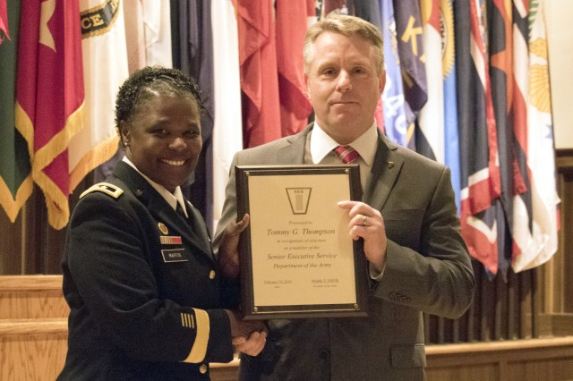 Gregg Thompson, right, receives his Senior Executive Service certificate from Maj. Gen. Donna Martin, Maneuver Support Center of Excellence commanding general, during Thompson's induction ceremony June 17. Thompson serves as the MSCoE deputy to the commanding general.