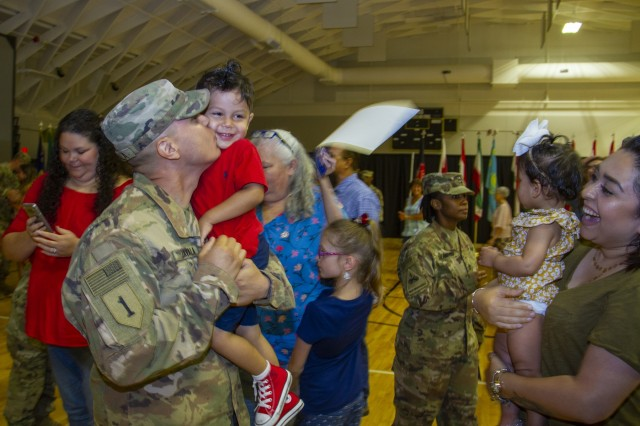 Master Sgt. Edgar Zavala greets his family after returning home from a six-month deployment June 19, 2019.U.S. Army Photo by Spc. Zoran Raduka