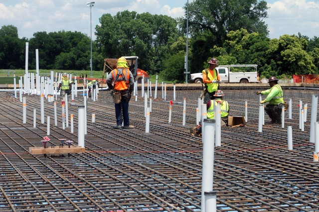 Water pipes sprout from the ribbed mat foundation for the 95th Adjutant General Battalion (Reception) future A Battery barracks reveal the beginning stages of what will be a laundry room at Fort Sill, Okla.