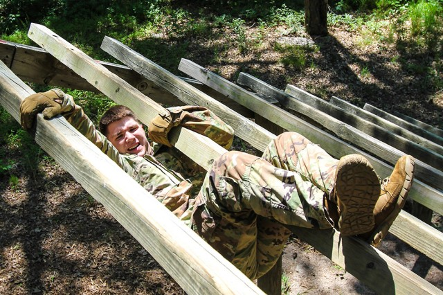 U.S. Army Intelligence and Security Command's (INSCOM) Best Warrior Noncommissioned Officer of the Year Sgt. Kyle Tamraz, a signals intelligence analyst from the 781st Military Intelligence (MI) Battalion, 780th MI Brigade, maneuvers his way through the obstacle course during the INSCOM Best Warrior Competition at Fort A.P. Hill, Virginia, June 4, 2019. Tamraz, will move on to the next level to compete at the U.S. Army Cyber Command Best Warrior Competition, scheduled to take place, July 22-26 at Camp Upshur, Quantico, Virginia.