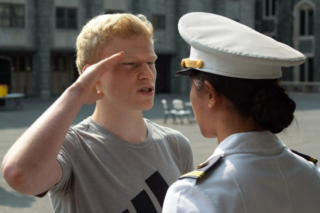 A Summer Leader Experience student learns how to salute while reporting to a upperclass cadet during SLE. SLE gives high school juniors a week to experience life as a cadet to enhance their college selection decision. SLE is a fast-paced program of academic classes, military training, physical fitness training and intramural athletics conducted each year in June. A group of SLE participants march to their next mission.