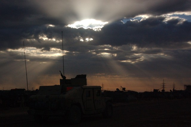 Dawn breaks over Fallujah. A member of the 1st Infantry Division snapped the photo during Operation Phantom Fury, also known as the Second Battle of Fallujah. In the evening darkness, the next Medal of Honor recipient, David Bellavia, fought his way up a three-story house, killing five insurgents.