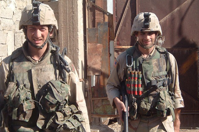 Staff Sgt. David Bellavia and Staff Sgt. Colin Fitts take a break during a patrol in Iraq in 2004. Bellavia and Fitts became close friends during difficult missions in the Second Battle of Fallujah.