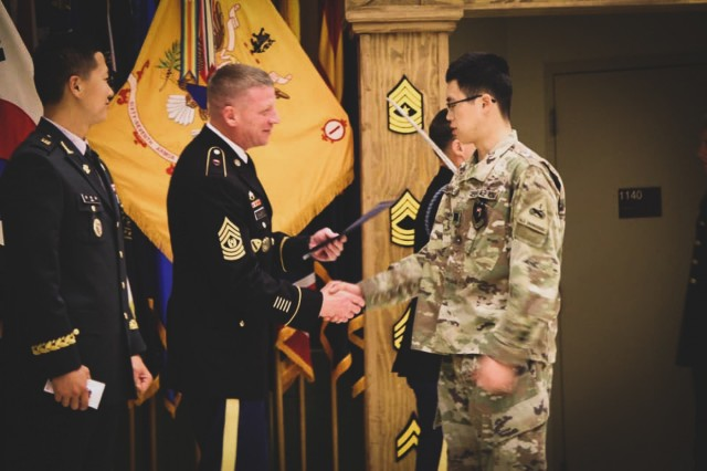 """CAMP HUMPHREYS, Republic of Korea - Command Sgt. Maj. Troy Willey, native of Bridgeville, Delaware, senior enlisted advisor to 1st Battalion, 67th Armor Regiment """"Death Dealers"""", 3rd Armored Brigade Combat Team """"Bulldog"""", 1st Armored Division (Rotational), 2nd Infantry Division/ ROK-U.S. Combined Division, welcomes Sgt. Sohn, Hyung Kyu, senior KATUSA with 1-67AR, 3ABCT, 1AD, into the non-commissioned officer corps at the Death Dealers NCO Induction Ceremony at Camp Humphreys, Republic of Korea, May 3. The NCO Induction Ceremony is a time-honored tradition symbolizing the transition from junior enlisted Soldier to the NCO Corps. (Courtesy photo)"""