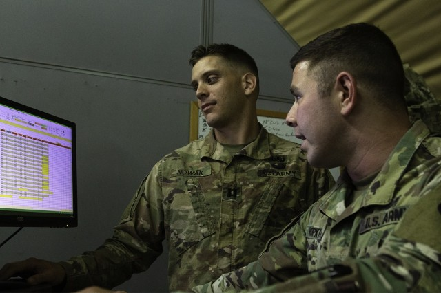 Capt.  Andrew Nowak, 594th Transportation Company commander, 129th Sustainment Battalion, 300th Sustainment Brigade, and 1st Lt. Fletcher Hopkins, executive officer, use the Operator Skill Tracker to evaluate Soldier's skills for future operations at Camp Arifjan, Kuwait, May 13, 2019. (U.S. Army Reserve photo by Capt. Jerry Duong)