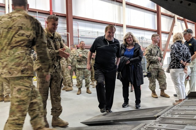Bruce Grable enters the ramp of a CH-47 Chinook helicopter with his wife at the 3rd General Support Aviation Battalion hangar June 20 at Fort Drum. Grable visited Fort Drum with retired Col. Dave Johnson, as the Vietnam War veterans were guest speakers for the Salute to the Nation ceremony on post. (Photo by Mike Strasser, Fort Drum Garrison Public Affairs)